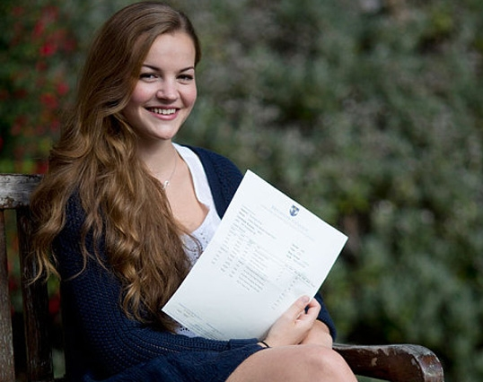 Izzy Meikle-Small celebrates gaining three A* grade A-levels at Brighton College