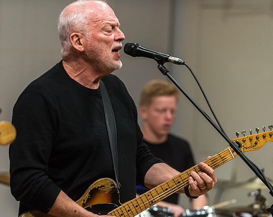 David Gilmour accompanied by 17-year-old pupil Alex Sansbury on drums