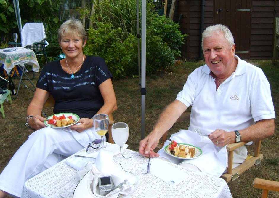 The Master, Richard Lynch-White, and his wife Lyn, enjoying a charity lunch in August at the house of Michael Sword Daniels (D. 1961-66), our Secretary
